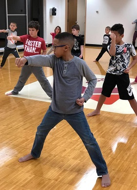 https://k3ymca.org/uploads/editor/images/Membership/young%20boy%20members%20in%20marial%20arts%20class.jpg